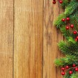 Christmas fir tree on wooden board — Stock fotografie