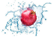 Pomegranate in spray of water. — Stock Photo