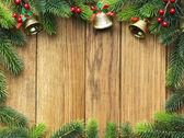 Christmas fir tree on wooden board — Stock Photo