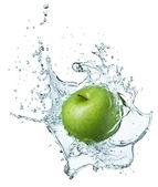 Green apple in water — Photo