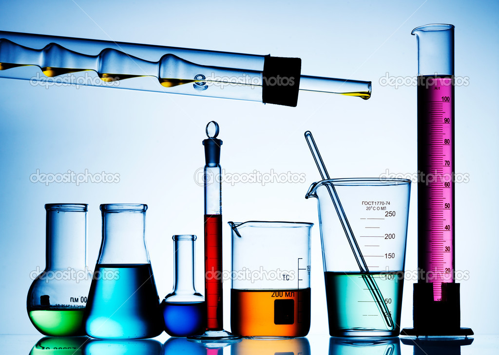 Flask with chemicals and test tubes over isolated background — Stock Photo #5133700