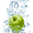 Apple in spray of water. - Stock Photo