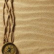 Vintage paper, rope and compass on sand — Stock Photo