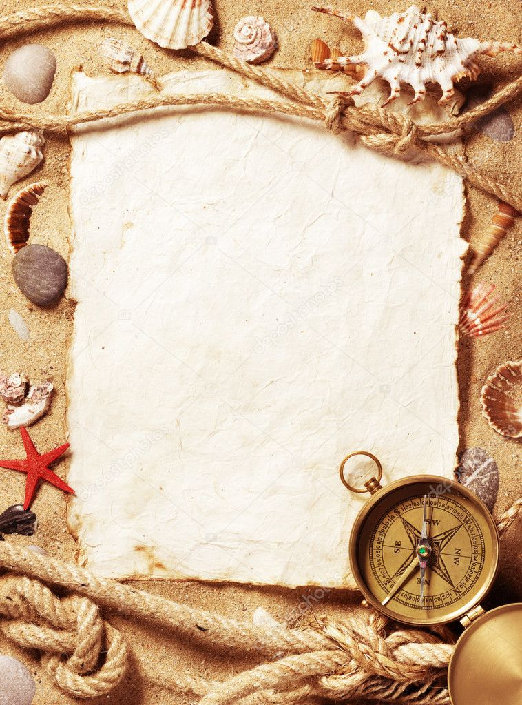 Old paper, compass, shell and rope on sand background — Stock Photo #5146076