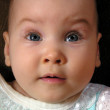 Stock Photo: Baby looks upwards