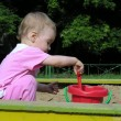 Baby in sandbox — Stock Photo