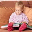 Baby with book - Stockfoto