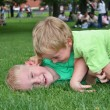 Children play in grass - Photo