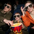 Family in stereo cinema. focus on popcorn — Stock Photo