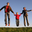 Sunset jump family — Stock Photo