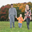 Autumn family walk — Stock Photo