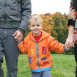 Stock Photo: Autumn child with family