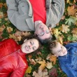 Royalty-Free Stock Photo: Family lies on maple leaves