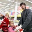 Father with children in shop — Stock Photo #3538194