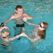 Stock Photo: Family in pool