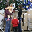 Family in christmas shop — Stock Photo #3538235
