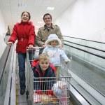 Family on shop elevator — Stock Photo