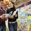 Stock Photo: Couple in postcards shop