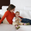 Mother with baby on sofa — Stock Photo #3538464