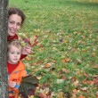 Autumn mother with child — Stock Photo