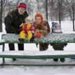 Family on bench. winter. — Stock Photo