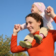 Stock Photo: Baby on mother shoulders
