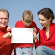 Family with card for text — Stock Photo