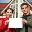 Couple with card and house — Stock Photo #3538920