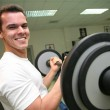 Gym man with barbell 2 — Stock Photo