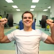 Gym man with dumbbells 3 — Stock Photo #3538961