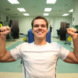 Gym man with dumbbells 3 - Stock Photo