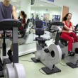 Boy and girl in health club - Stockfoto