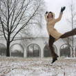 Winter jump girl - Stock Photo