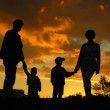 Stock Photo: Family of four sunset 2