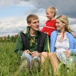 Stock Photo: Family on meadow waiting next child