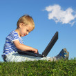 Child with notebook sit blue sky with cloud — Stock Photo