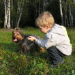 Child with dog sundown wood — Stock Photo