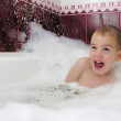 Boy in bath hides from streem of water — Stock Photo #3539710