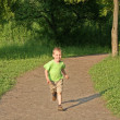 Running boy from wood — Stock Photo