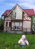 Baby in yard — Stock Photo