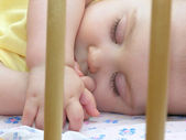 Baby sleep in bed — Stock Photo