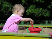 Baby in sandbox — Foto Stock