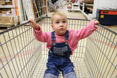 Baby in shop carriage — Stock Photo