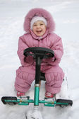 Happy baby on sled — Stock Photo