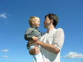 Father with son on hands sunny day — Stock Photo