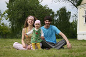 Family with baby in the yard — Stock Photo