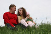 Family with baby on grass — Stock Photo