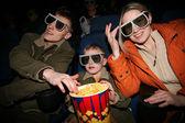 Family in stereo cinema. focus on popcorn — Stock fotografie