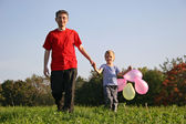 Father with son and balloon — Stock Photo