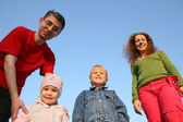 Family of four from down — Stock Photo